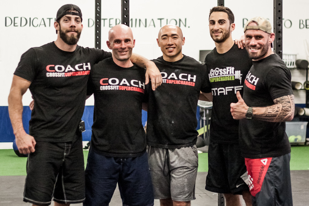A few of our coaches smile for the camera before giving the next class the ultimate work out